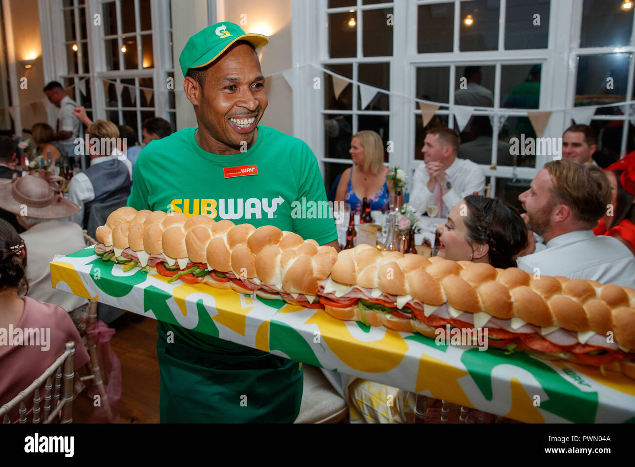7fa6b2c9b460c Subway Sandwich Artists Justin Pringle and Yasoda Jayaweera deliver a BMT  Giant Sub to the wedding ...