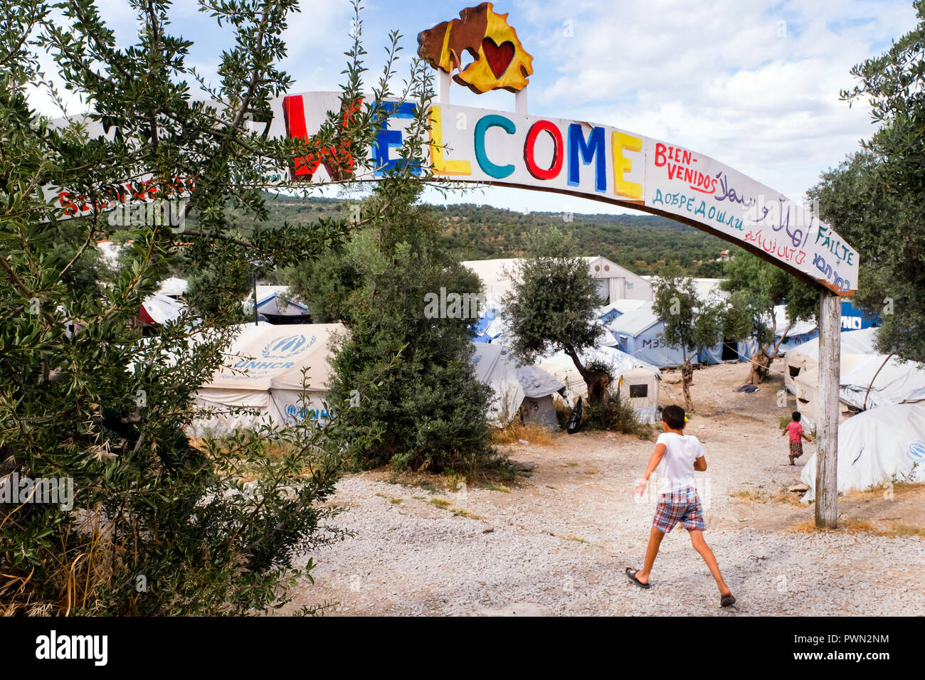 Welcome sign above the tent camp next to the camp MORIA CAMP for refugees who came over by boat from nearby Turkey. Island of Lesbos, Greece, May 2018 - Stock Image