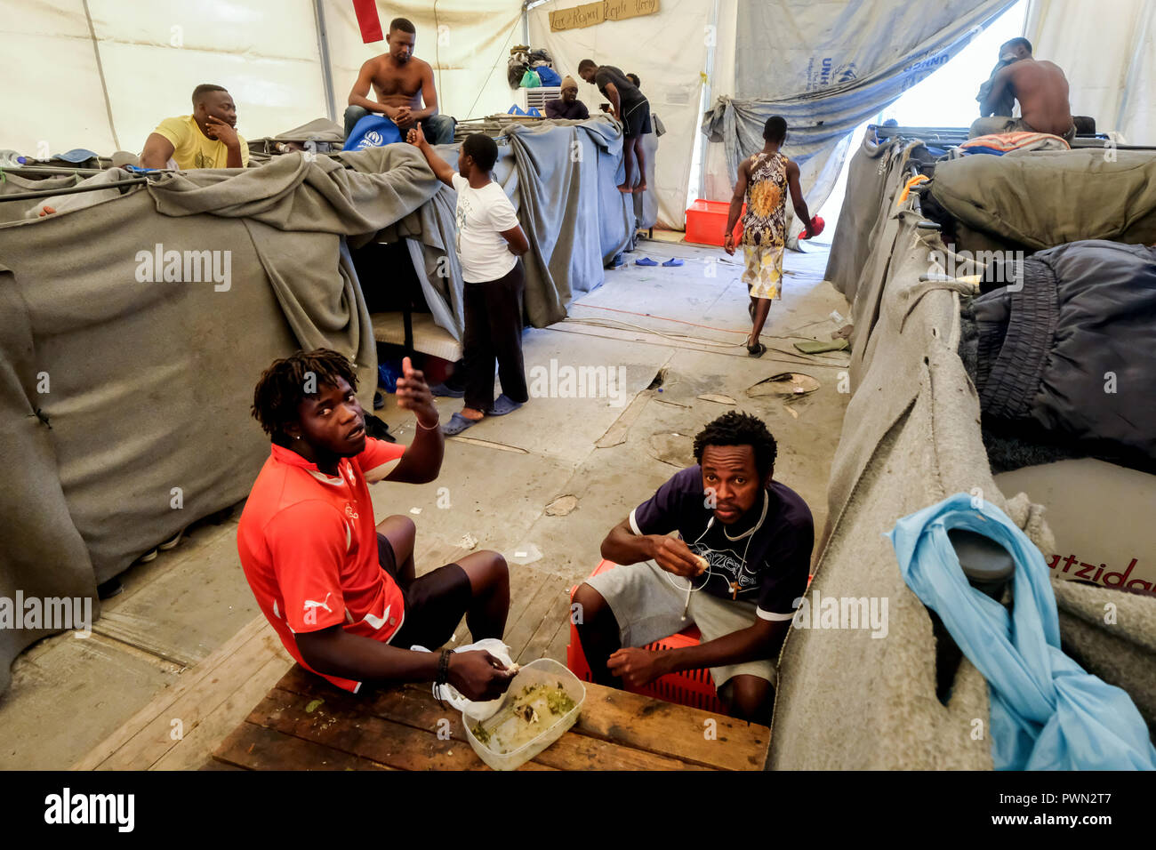 Refugees from Africa in a the next to MORIA-CAMP for refugees who came over by boats from nearby Turkey. Island of Lesbos, Greece, May 2018 - Stock Image