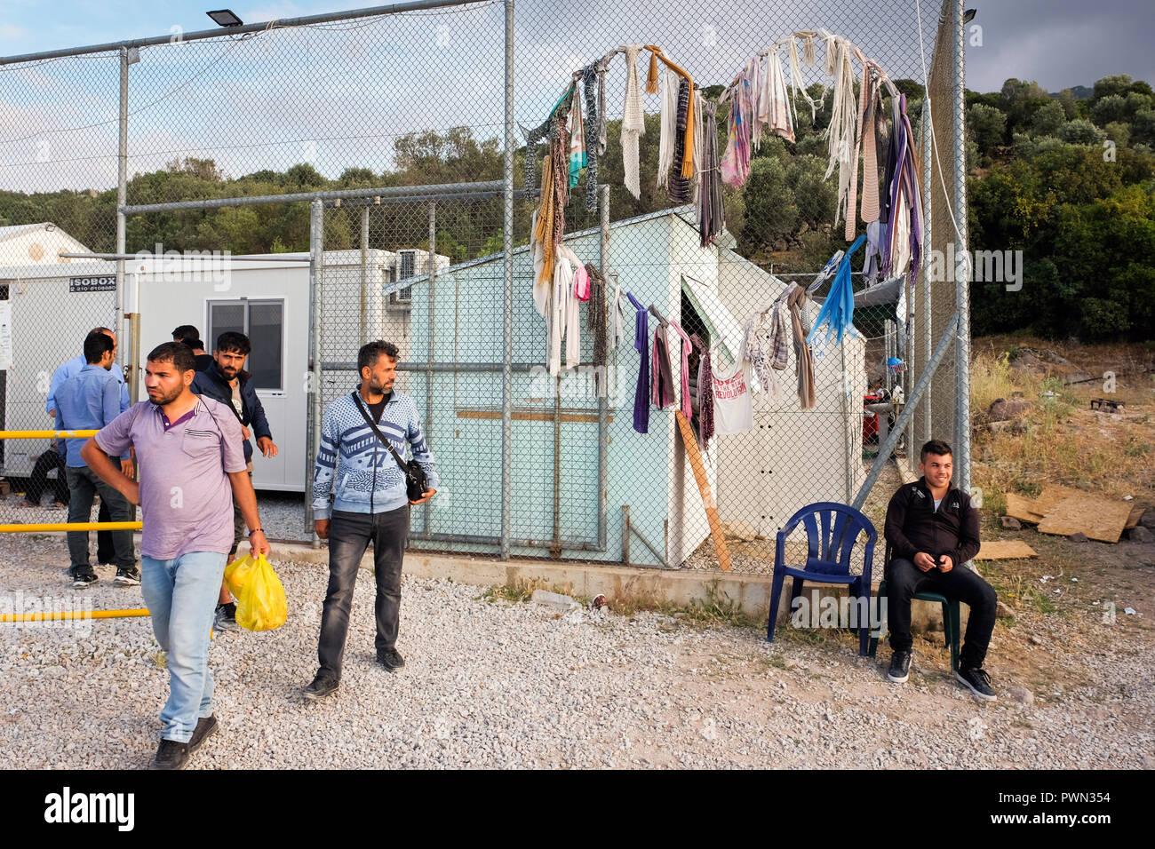 Refugees in front of the first station of the camp MORIA CAMP for refugees. Island of Lesbos, Greece, May 2018 - Flüchtlinge vor dem ersten Station des Lagers MORIA CAMP für Flüchtlinge. Insel Lesbos, Griechenland, Mai 2018 - Stock Image