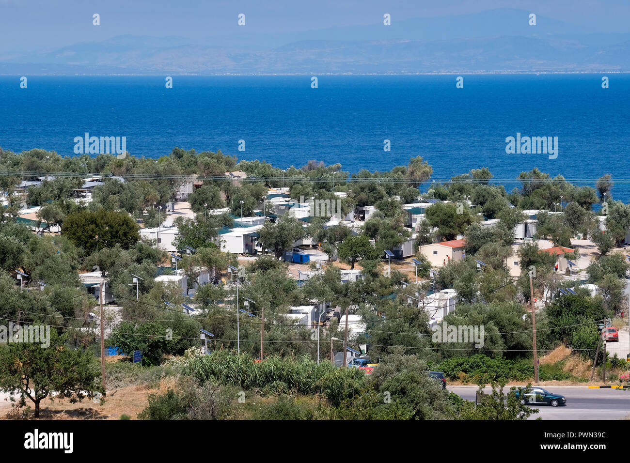 KARA TEPE Hospitality Center for Refugees and Migrants, local refugee camp near the island capital of Mytilene, on the island of Lesbos, Greece. In the background the coast of Turkey. May 2018 - KARA TEPE Hospitality Center for Refugees and Migrants, lokales Flüchtlingscamp nahe der Inselhauptstadt Mytilini, auf der Insel Lesbos, Griechenland. Im Hintergrund die Küste der Türkei. Mai 2018 - Stock Image