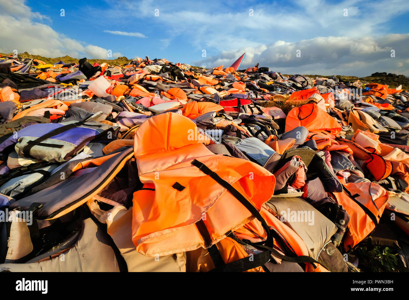 Lifevests of refugees escaping from Turkey across the Mediterranean to the island of Lesbos piling on a garbage landfill at Molivos, Lesvos Island, Greece, May 2018 - Friedhof der Schwimmwesten auf einer Mülldeponie bei Molivos, Insel  Lesbos, Griechenland, Mai 2018 - Stock Image