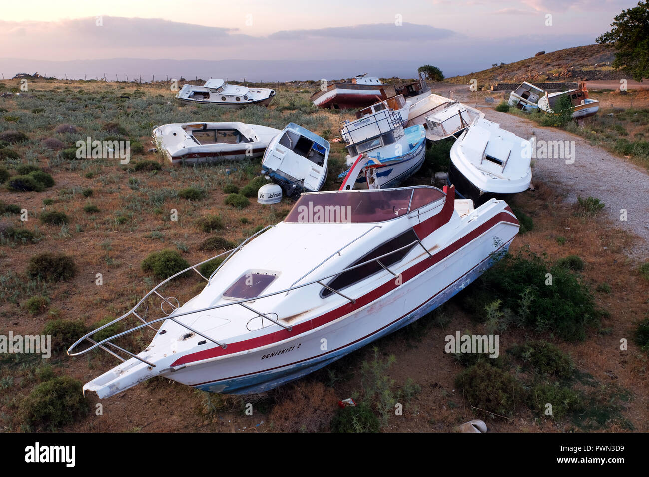 Dameged boats of refugees who have fled from Turkey across the Mediterranean Sea lie on a garbarge landfill near Molivos, Lesvos Island, Greece, in May 2018 - Fluchtboote auf einer Mülldeponie bei Molivos, Insel  Lesbos, Griechenland, Mai 2018 - Stock Image