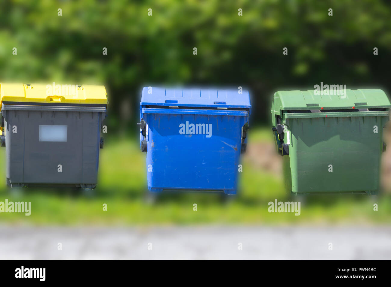 Industrial Waste Containers Dumpster for municipal and private waste or industria. Background with blur Stock Photo