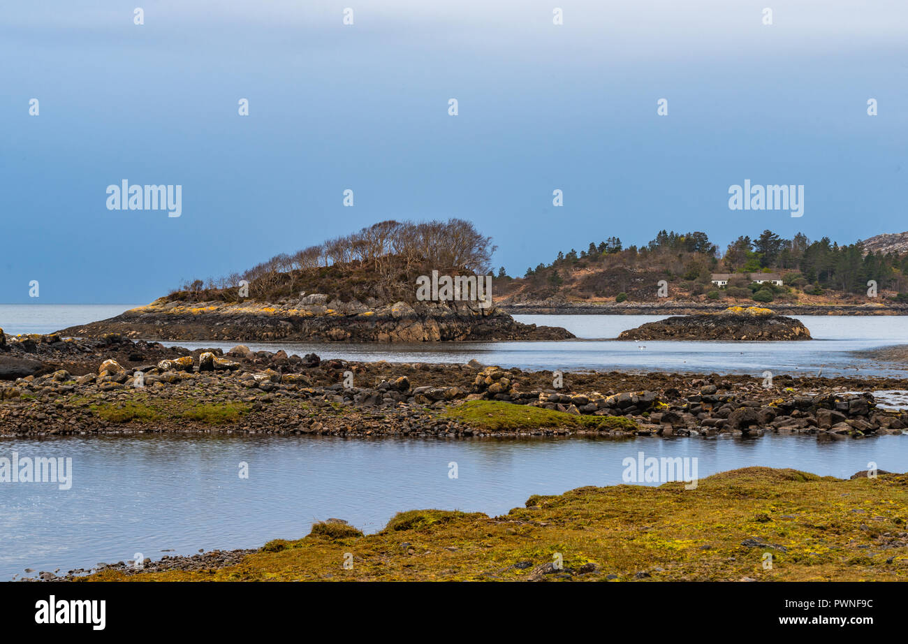 A cove with small islands, near Ullapool,  Lairg, Scotland, West Highlands, Uk, - Stock Image