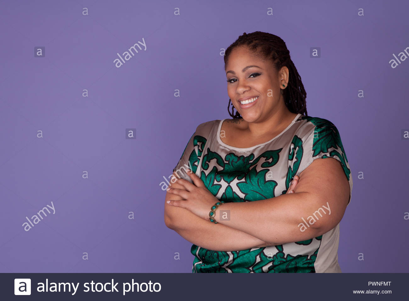 Beautiful Plus Size Black Woman Standing On A Purple Background