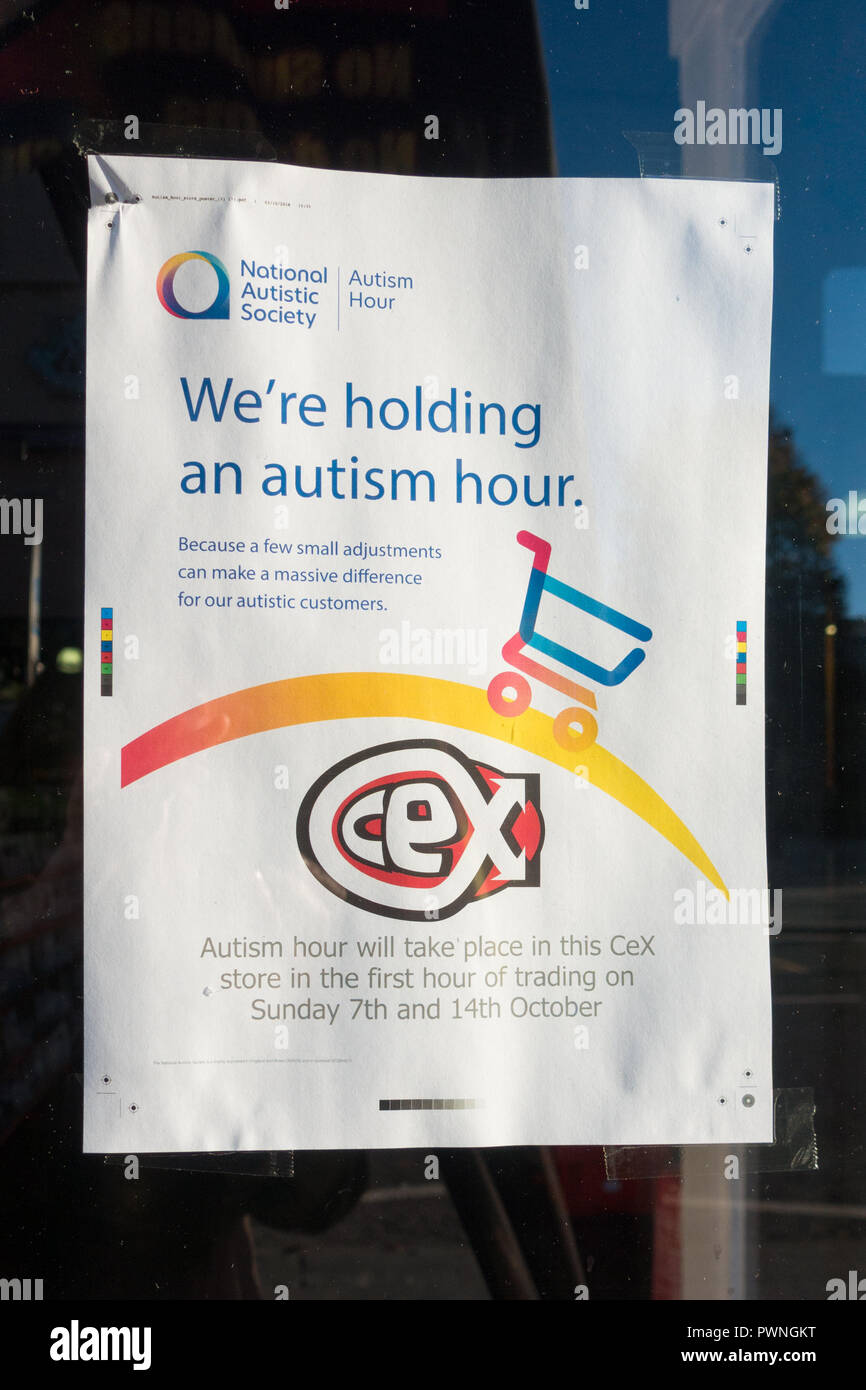 Autism Hour advertising poster in CeX shop window, Dundee, Scotland, UK - Stock Image