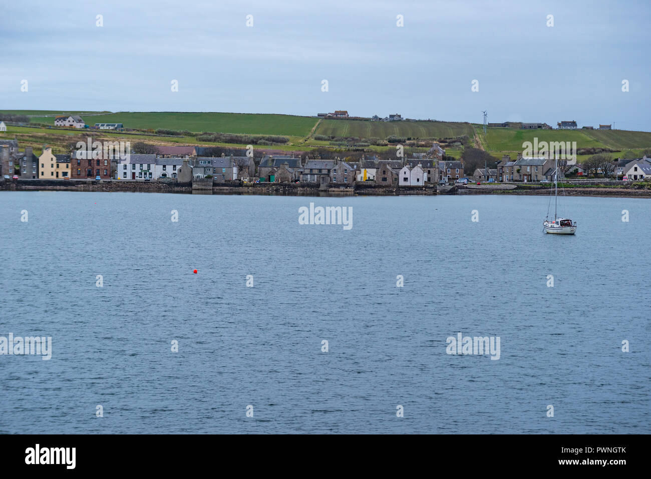 View from a ferry onto the waterfront of Stromness, Orkney Islands, Scotland, Uk - Stock Image