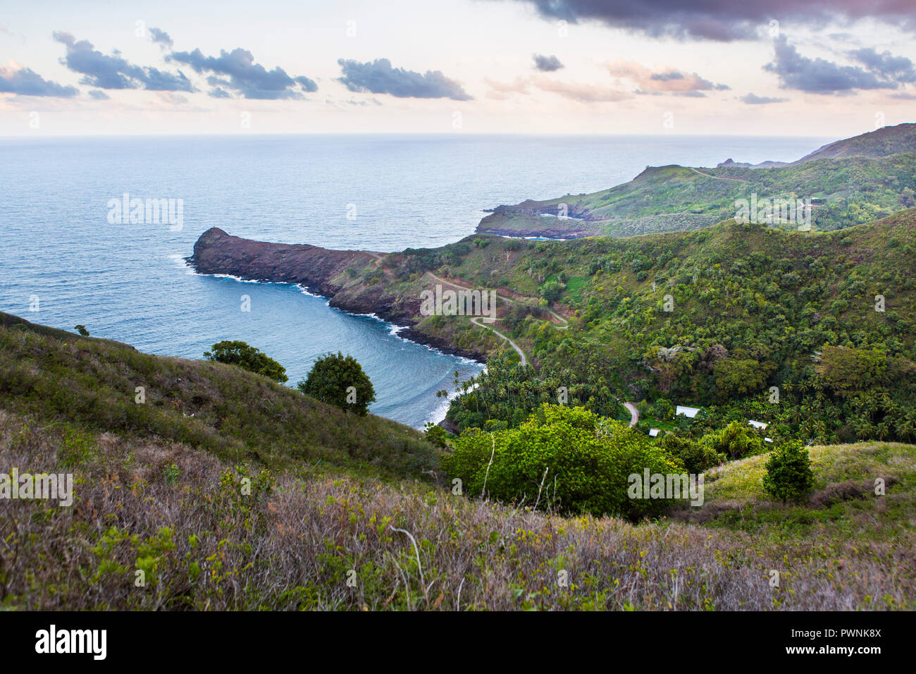Landscape and Tautepe cap at dusk on the north coast of the island of Hiva Oa, Marquesas Islands, French Polynesia - Stock Image