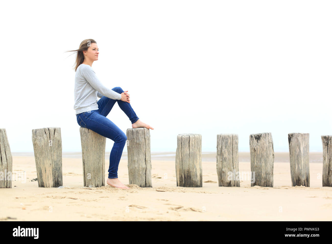 Young woman on the beach. Burn out - Stock Image