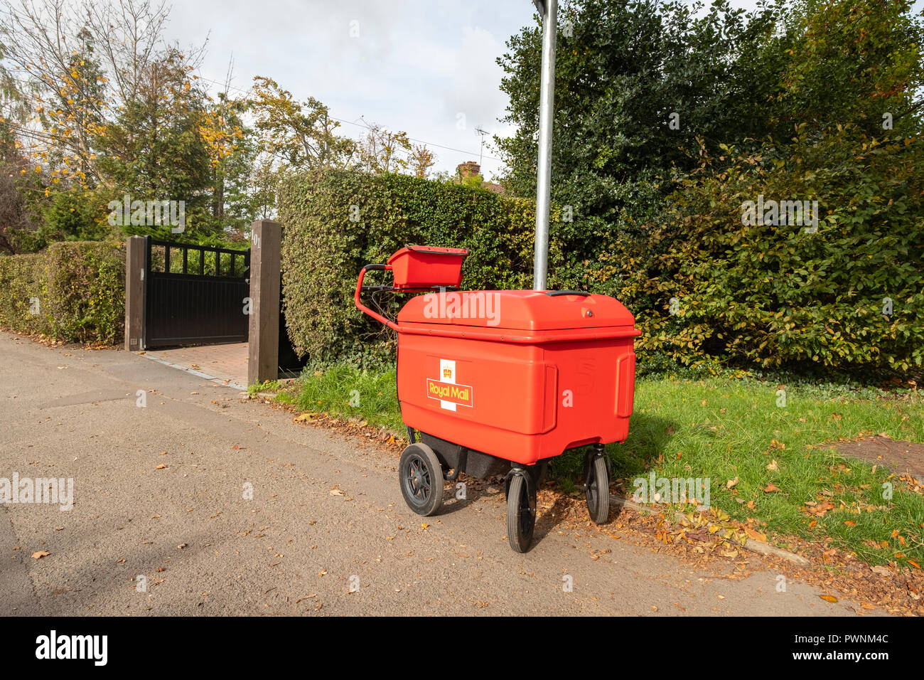 Royal Mail delivery trolley locked or secured on lamppost in Cheshire UK - Stock Image