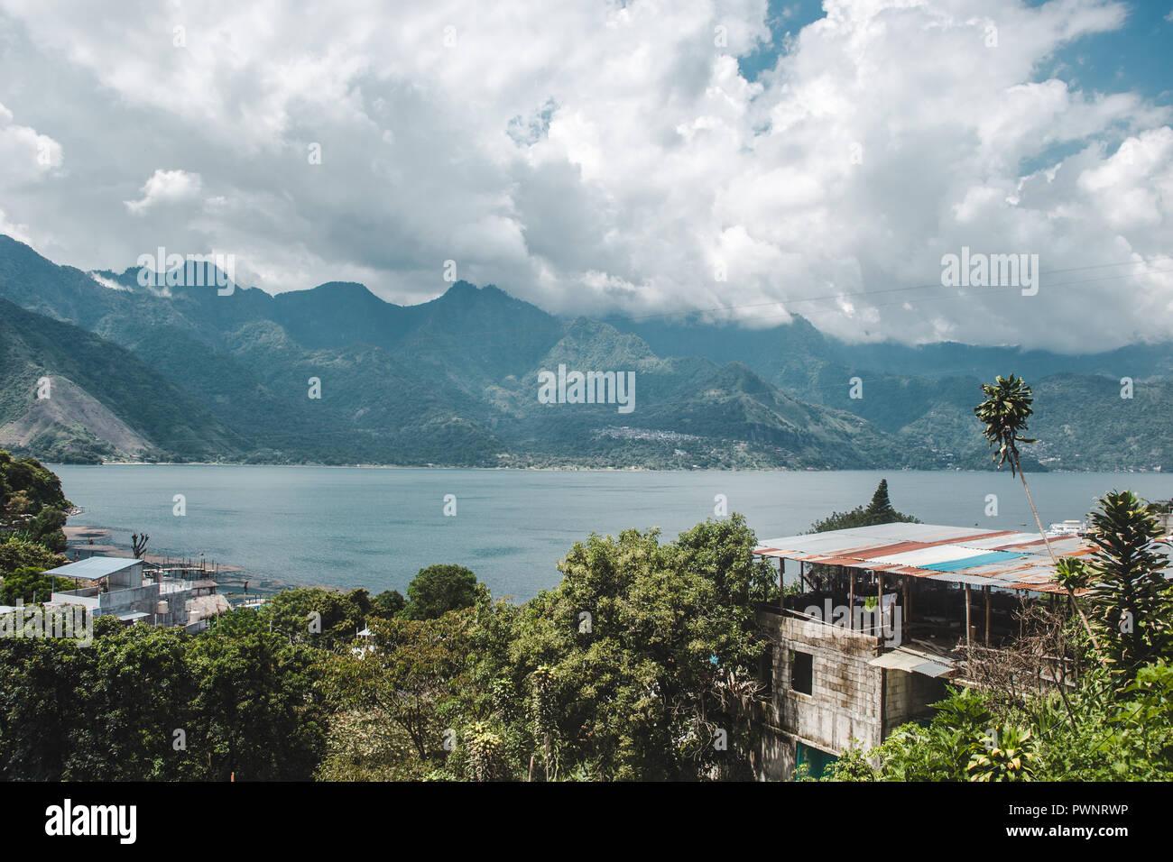 View over the lush and blue landscape around Lake Atitlán, Guatemala - Stock Image