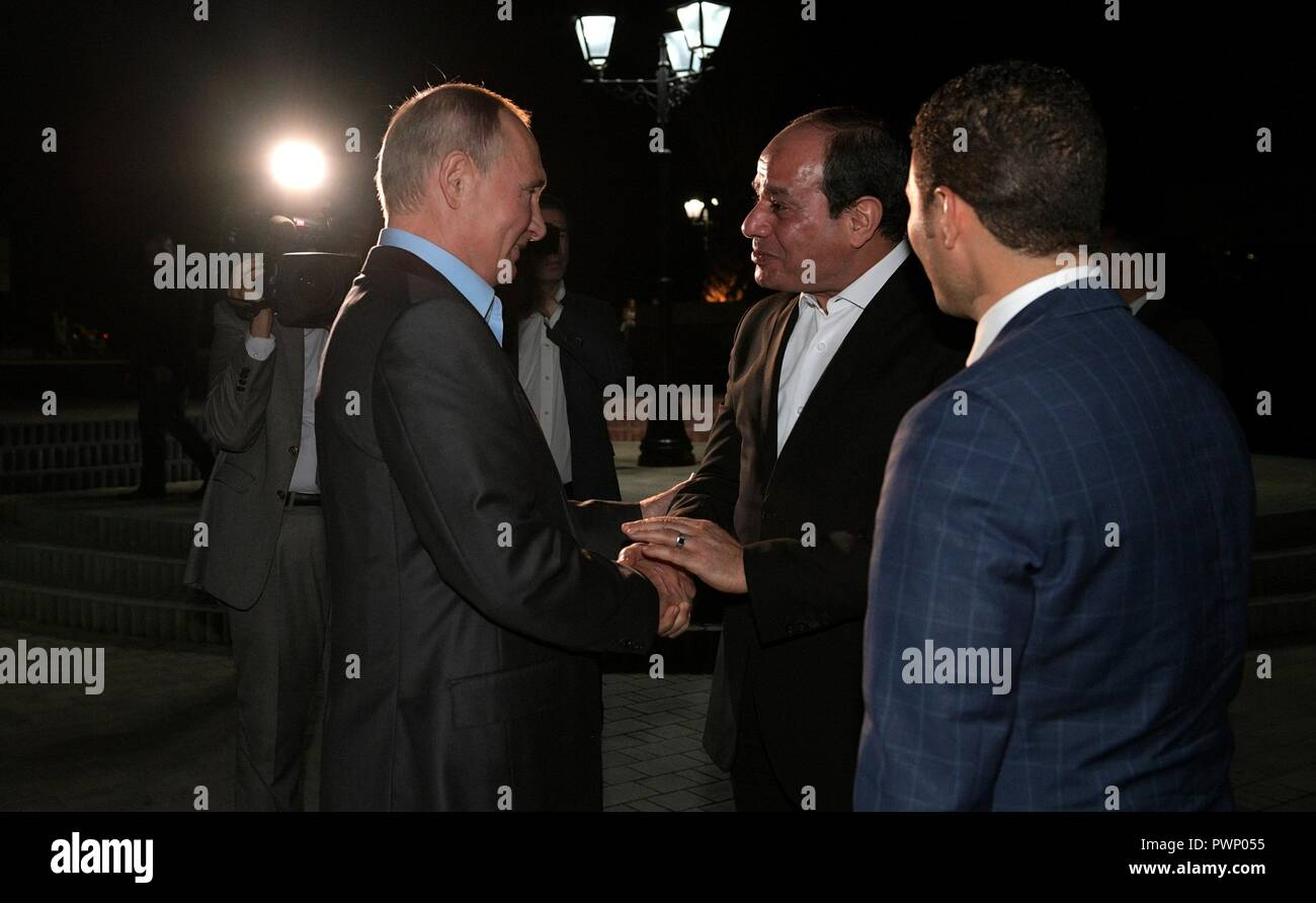 Russian President Vladimir Putin greets Egyptian President Abdel Fattah el-Sisi for an Informal meeting while taking an evening walking around the city October 16, 2018 in Sochi, Russia. Stock Photo