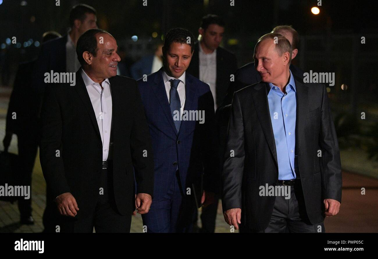 Russian President Vladimir Putin walks with Egyptian President Abdel Fattah el-Sisi, left, for an Informal meeting while taking an evening out around the city October 16, 2018 in Sochi, Russia. Stock Photo
