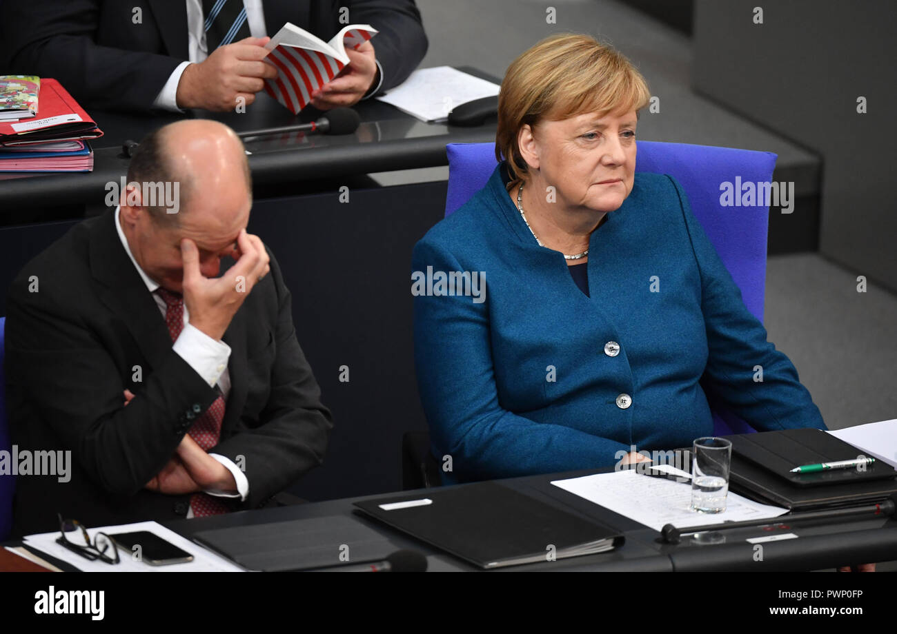 Berlin, Germany. 17th Oct, 2018. Federal Chancellor Angela Merkel (CDU) sits next to Vice-Chancellor Olaf Scholz (SPD) at the plenary session in the German Bundestag after her government declaration on the EU summit in Brussels. The 57th session of the 19th legislature will focus on European policy. Photo: Bernd Von Jutrczenka/dpa Credit: dpa picture alliance/Alamy Live News - Stock Image