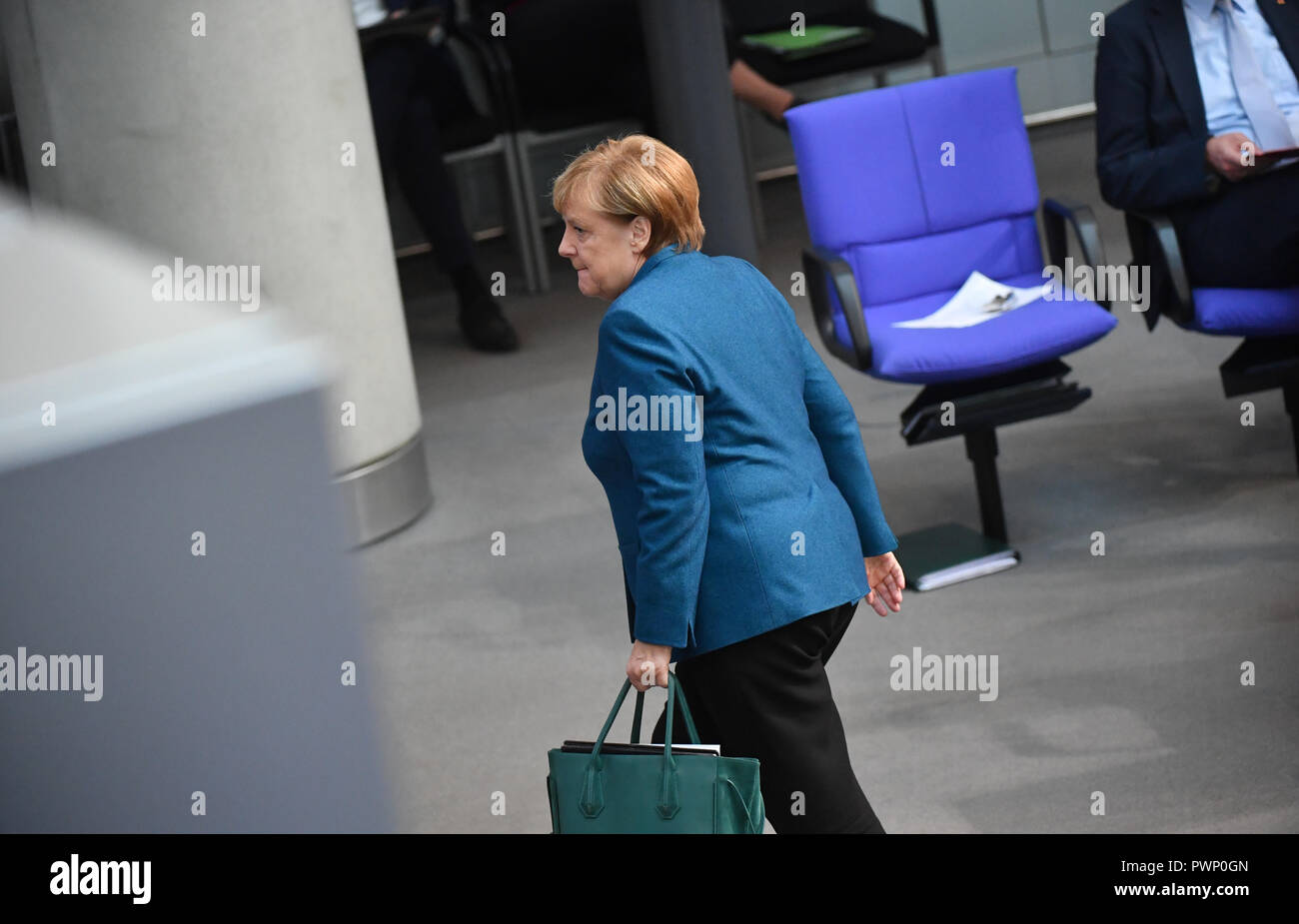 Berlin, Germany. 17th Oct, 2018. Chancellor Angela Merkel (CDU) is leaving the plenary session in the German Bundestag after her government declaration on the EU summit in Brussels. The 57th session of the 19th legislature will focus on European policy. Photo: Bernd Von Jutrczenka/dpa Credit: dpa picture alliance/Alamy Live News - Stock Image