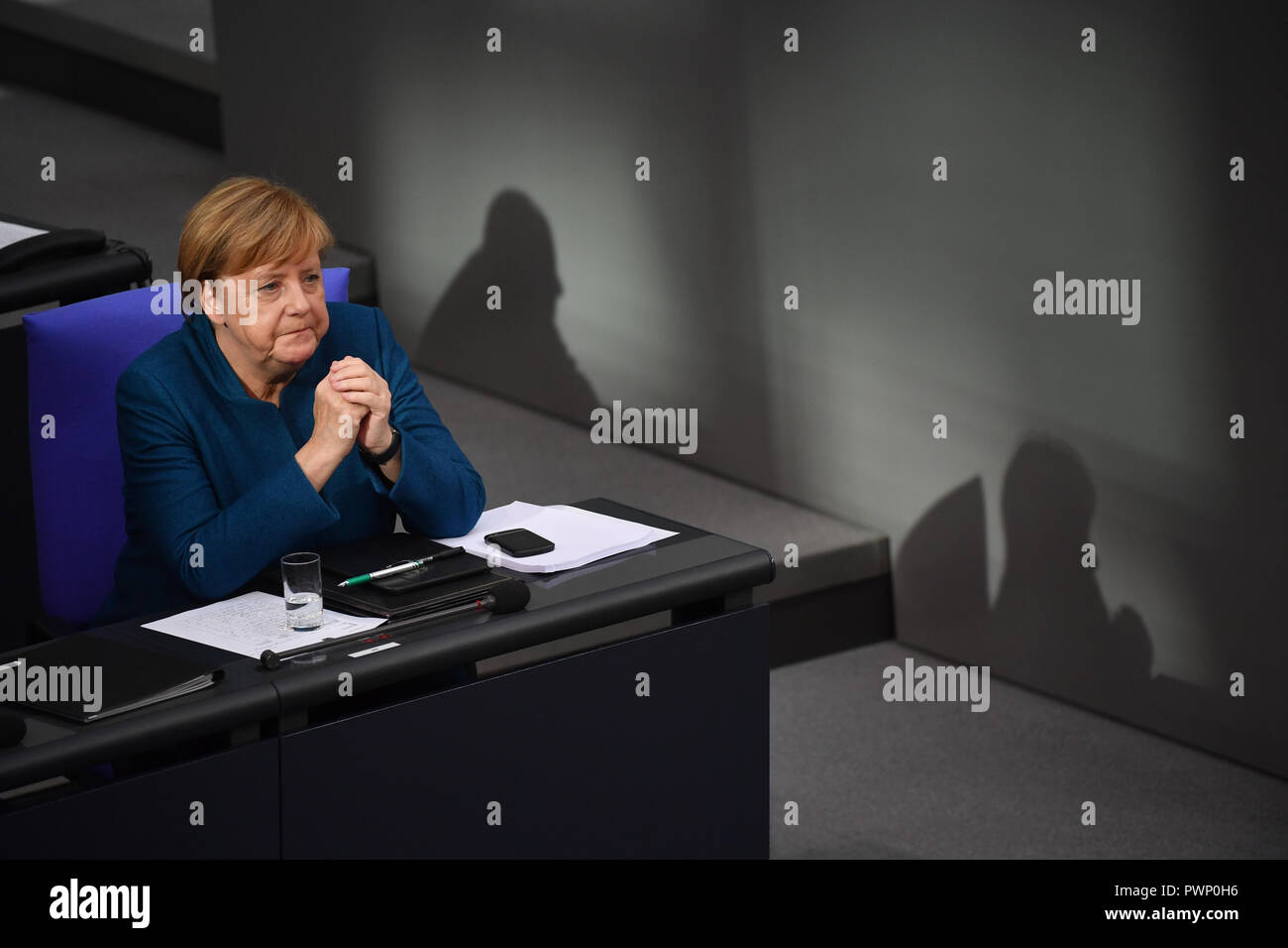 Berlin, Germany. 17th Oct, 2018. Chancellor Angela Merkel (CDU) sits in the government bench at the plenary session of the German Bundestag after her government declaration on the EU summit in Brussels. The 57th session of the 19th legislature will focus on European policy. Photo: Bernd Von Jutrczenka/dpa Credit: dpa picture alliance/Alamy Live News - Stock Image
