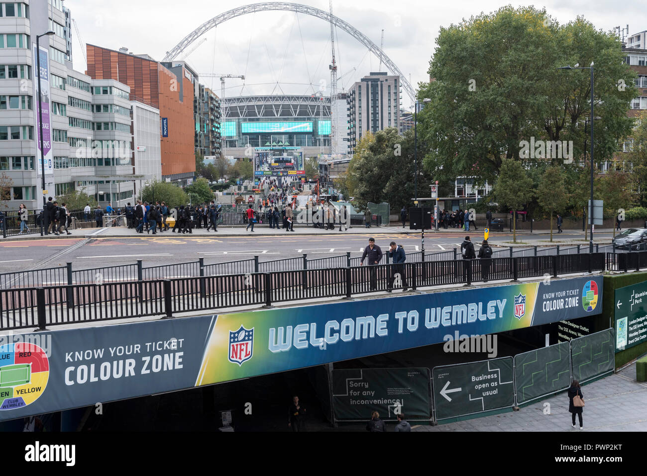 London, UK.  17 October 2018.  A general view of Wembley Stadium as seen from Wembley Park tube station.  The area is currently decorated with NFL branding to promote the current three game series of NFL games at the stadium.  Shahid Khan, owner of Fulham FC and the Jacksonville Jaguars NFL team, has withdrawn his £600m offer to buy the stadium, amidst reports that he did not feel that he would receive sufficient support from The Football Association (FA).  The FA was due to vote on the potential sale on October 24.  Credit: Stephen Chung / Alamy Live News - Stock Image