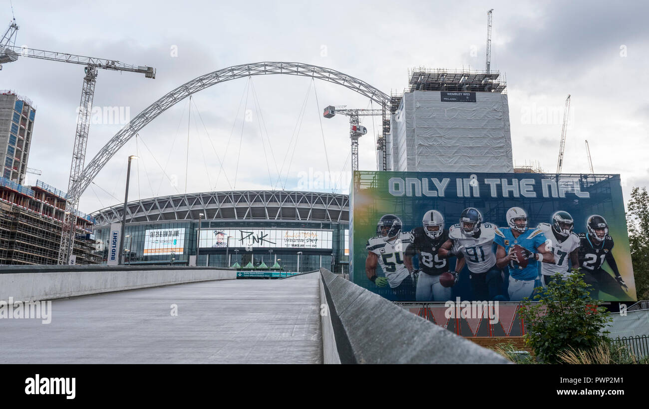 London, UK.  17 October 2018.  A general view of Wembley Stadium.  The area is currently decorated with NFL branding to promote the current three game series of NFL games at the stadium.  Shahid Khan, owner of Fulham FC and the Jacksonville Jaguars NFL team, has withdrawn his £600m offer to buy the stadium, amidst reports that he did not feel that he would receive sufficient support from The Football Association (FA).  The FA was due to vote on the potential sale on October 24.  Credit: Stephen Chung / Alamy Live News - Stock Image