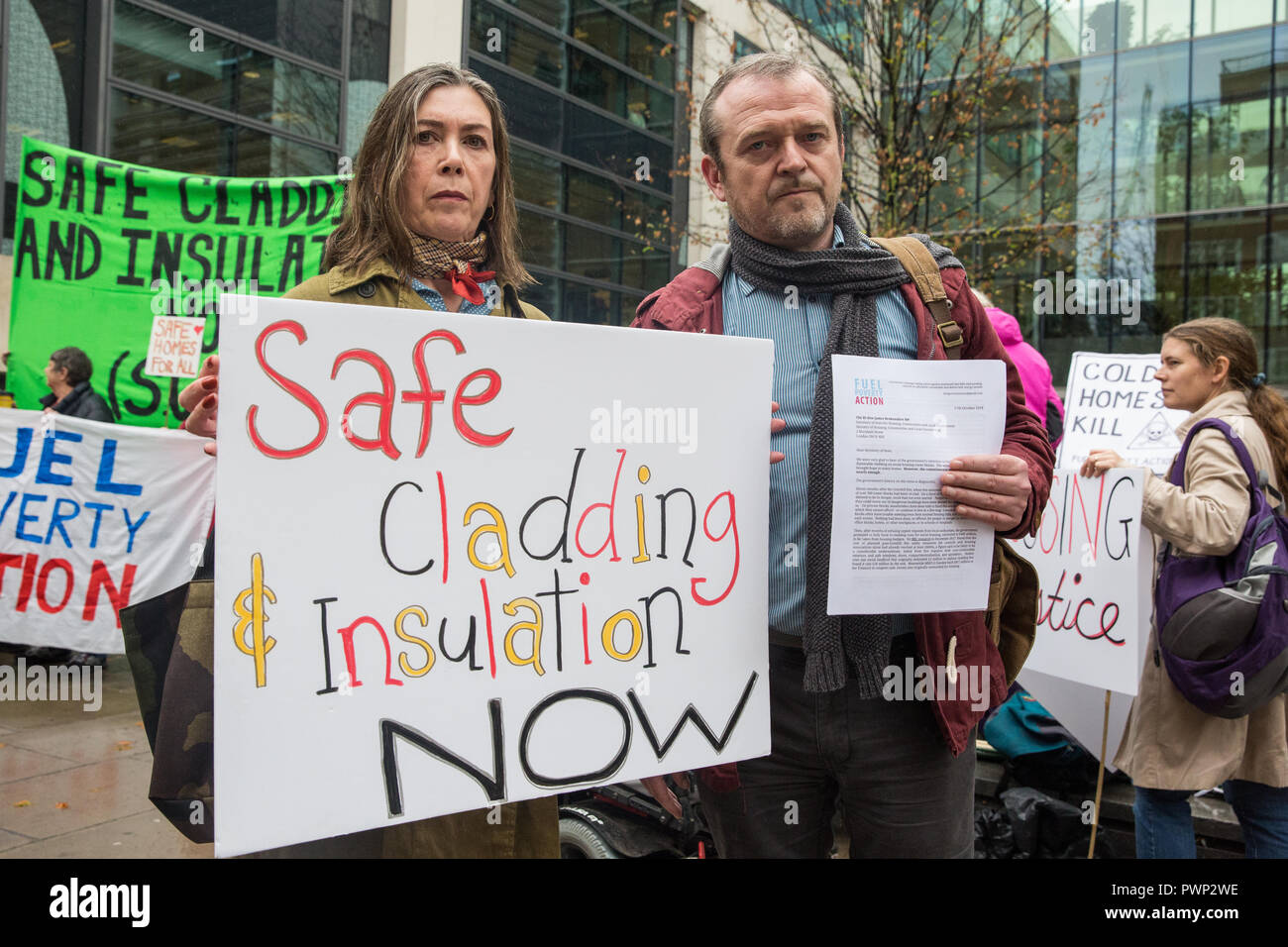 London, UK. 17th October, 2018. Leaseholder Beverley Reynolds-Logue from Manchester and Phil Murphy of Fuel Poverty Action prepare to present a letter to the Secretary of State for Housing, Communities and Local Government to demand urgent action and funding to protect tower block residents both from fire and from cold. The 140 signatories of the letter include MPs, councillors, trade union bodies and campaign groups focused on housing, poverty, discrimination, health, energy and climate. Credit: Mark Kerrison/Alamy Live News - Stock Image