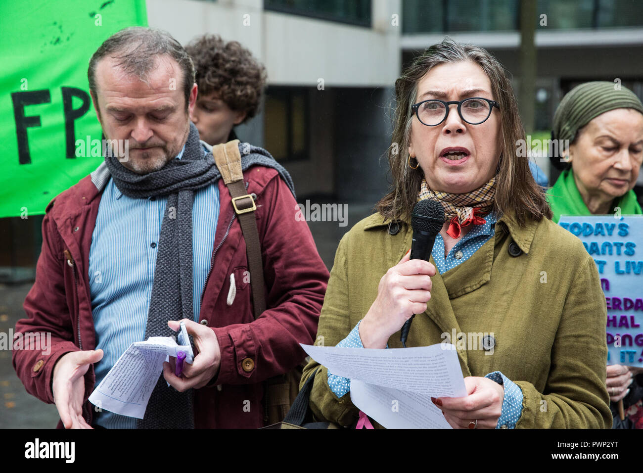 London, UK. 17th October, 2018. Leaseholder Beverley Reynolds-Logue from Manchester addresses tower block residents and supporters of grassroots campaign group Fuel Poverty Action at a protest outside the Ministry of Housing, Communities and Local Government to demand urgent action and funding to protect tower block residents both from fire and from cold. A letter signed by 140 signatories including MPs, councillors, trade union bodies and campaign groups focused on housing, poverty, discrimination, health, energy and climate was also presented. Credit: Mark Kerrison/Alamy Live News - Stock Image