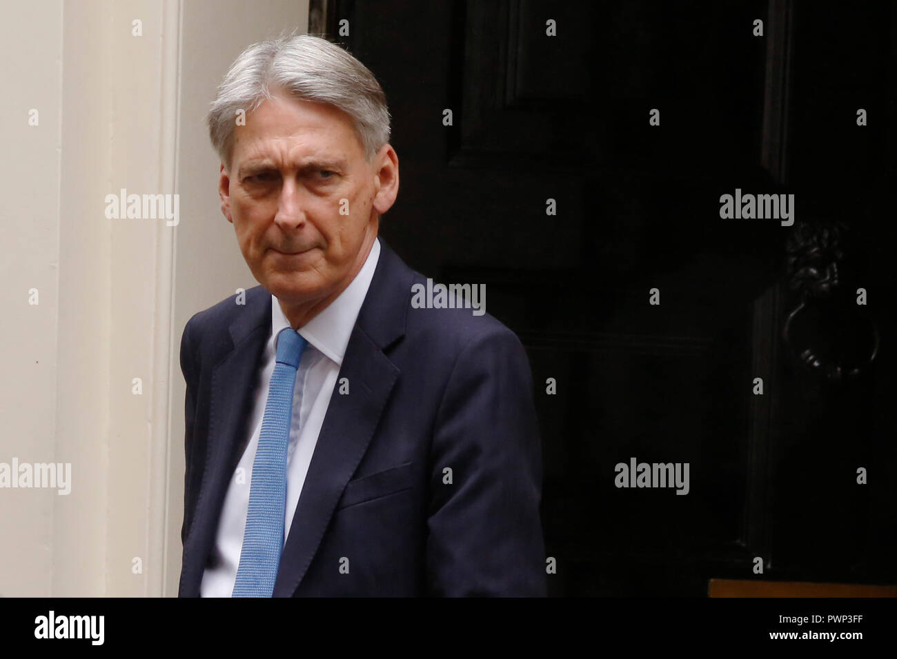 London, UK. 17th Oct, 2018. Britain's Chancellor of the Exchequer Philip Hammond leaves, Downing Street ahead of Prime Ministers Questions in London, Wednesday October 17, 2018. Credit: Luke MacGregor/Alamy Live News Stock Photo