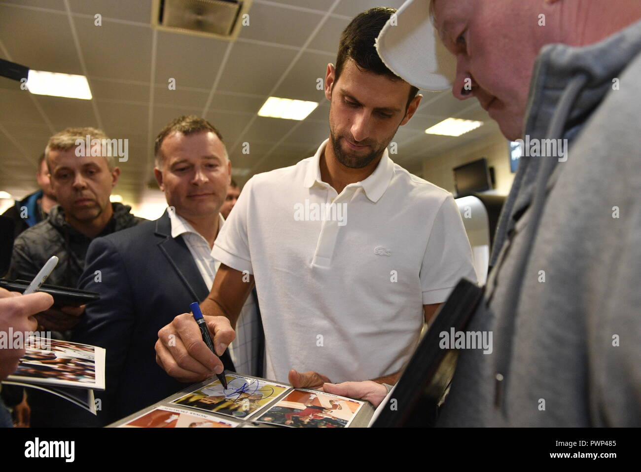 Prague, Czech Republic. 17th Oct, 2018. Serbian tennis star Novak Djokovic, centre, gives an autographs to fans, as he arrived to Prague on Wednesday, October 17, 2018, prior to the tomorrow's farewell party of tennis player Radek Stepanek ending his career. Credit: Michal Kamaryt/CTK Photo/Alamy Live News - Stock Image