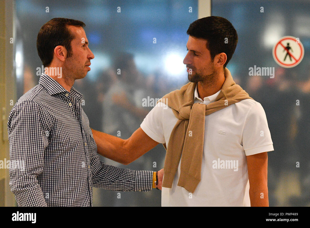 Prague, Czech Republic. 17th Oct, 2018. Serbian tennis star Novak Djokovic, right, greets with Radek Stepanek as he arrived to Prague on Wednesday, October 17, 2018, prior to the tomorrow's farewell party of tennis player Stepanek ending his career. Credit: Michal Kamaryt/CTK Photo/Alamy Live News - Stock Image