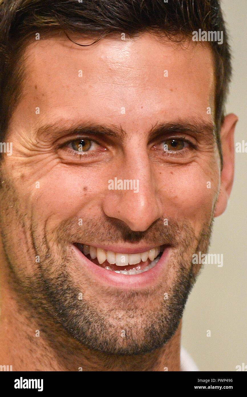 Prague, Czech Republic. 17th Oct, 2018. Serbian tennis star Novak Djokovic, photo, smiles as he arrived to Prague on Wednesday, October 17, 2018, prior to the tomorrow's farewell party of tennis player Radek Stepanek ending his career. Credit: Michal Kamaryt/CTK Photo/Alamy Live News - Stock Image