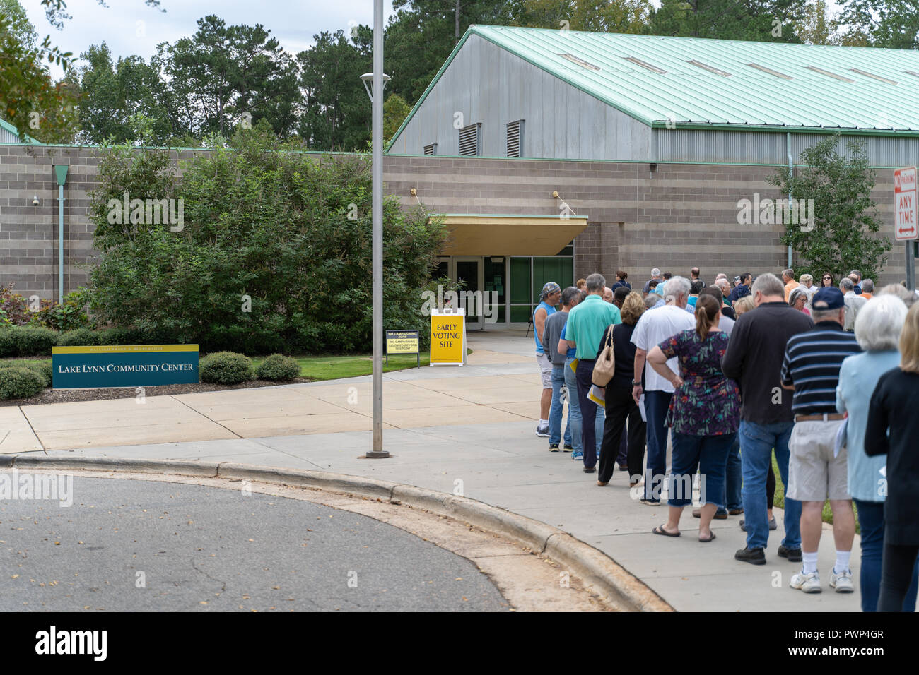Raleigh, North Carolina, USA. 17th Oct, 2018.  Early voting begins today for 2018 midterm elections, Lake Lynn Community Center. Voters waiting in line to cast their ballot for 2018 midterms. Credit: Michael Reilly/Alamy Live News - Stock Image