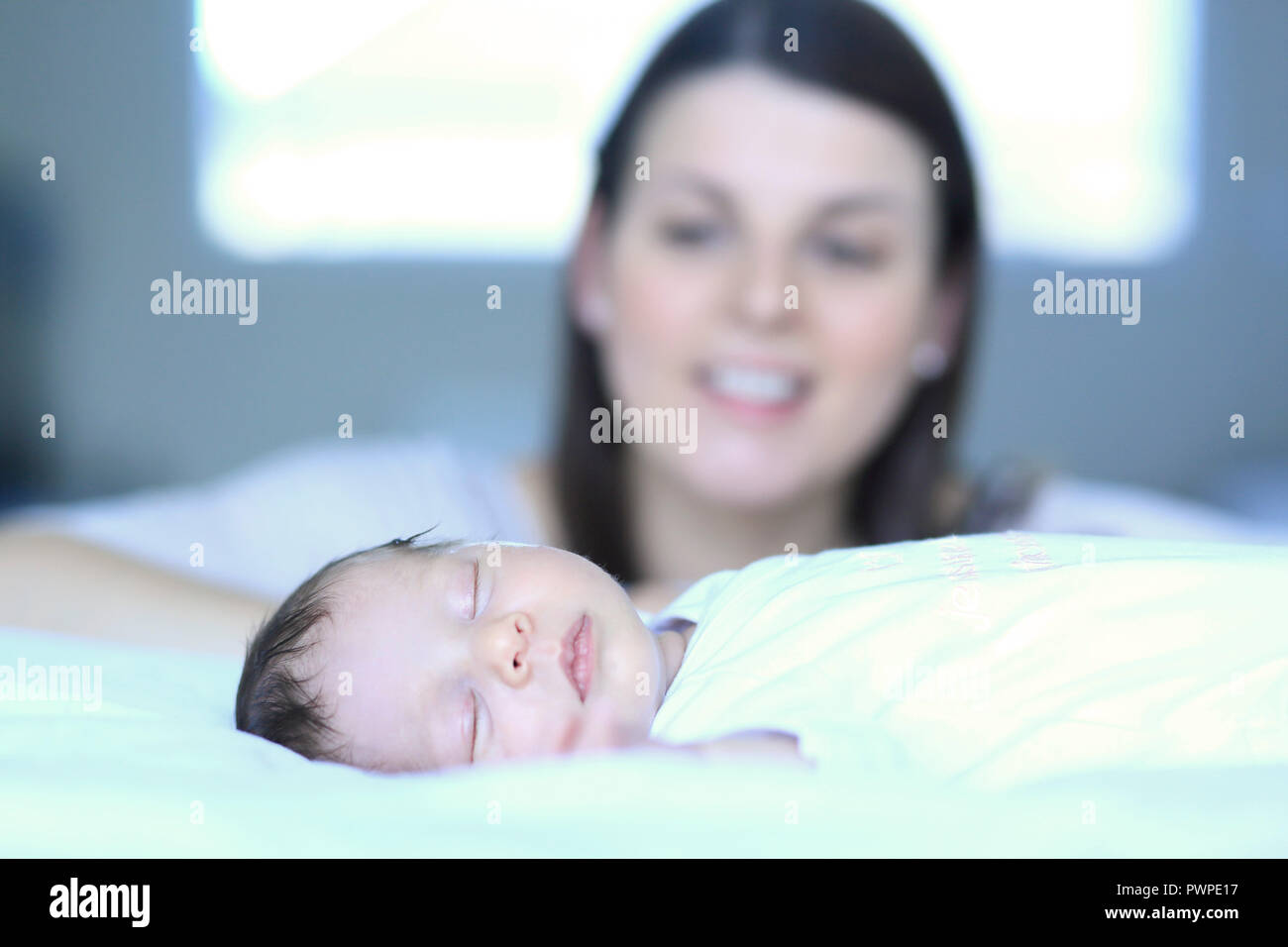 Baby with mother at home - Stock Image