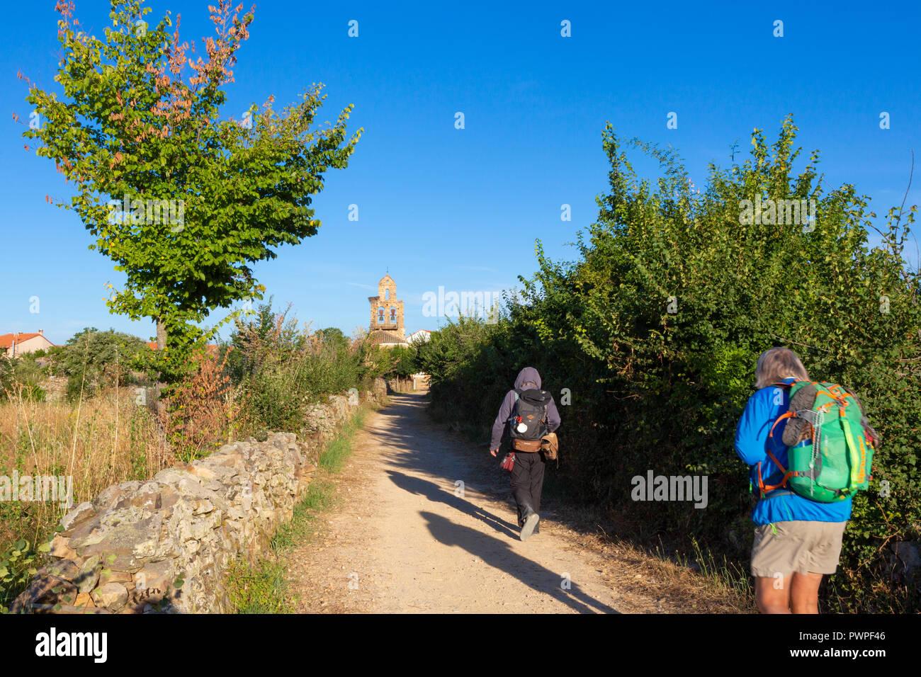 Camino de Santiago (Spain) - Pilgrims walking along the way of St.James, in the spanish meseta Stock Photo
