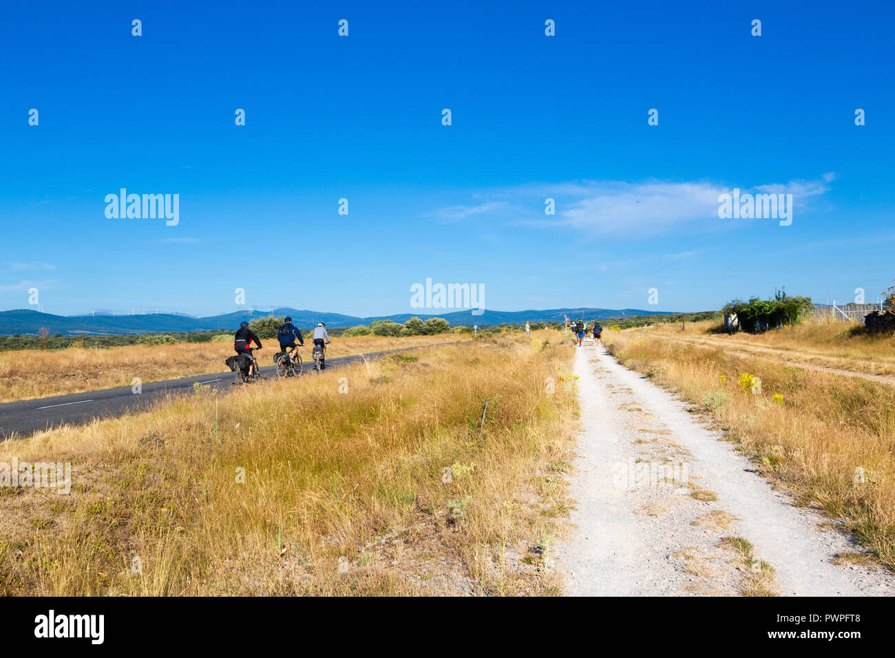 Camino de Santiago (Spain) - Pilgrims and bikers along the way of St.James, in the spanish meseta Stock Photo