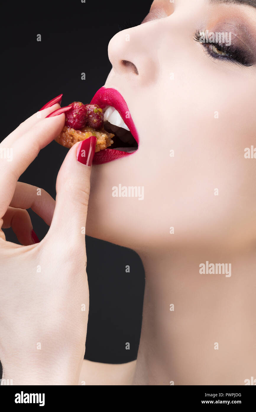 Tight shot of girl tasting red fruit tart Stock Photo