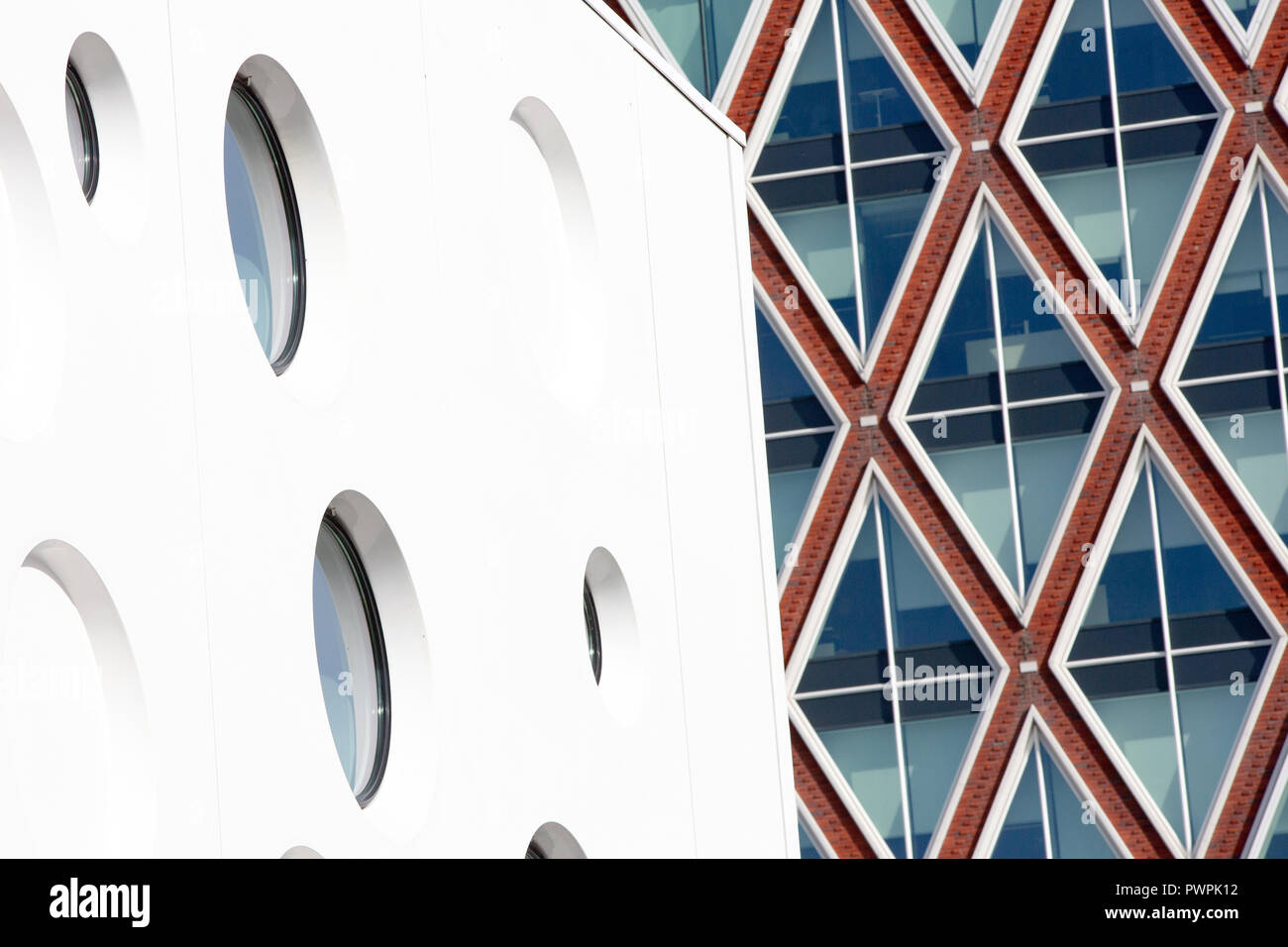 NETHERLANDS - 12 OCTOBER, 2018: Modern Dutch Architecture: Detail of the cinema with the town hall municipality of Gouda in the background. - Stock Image
