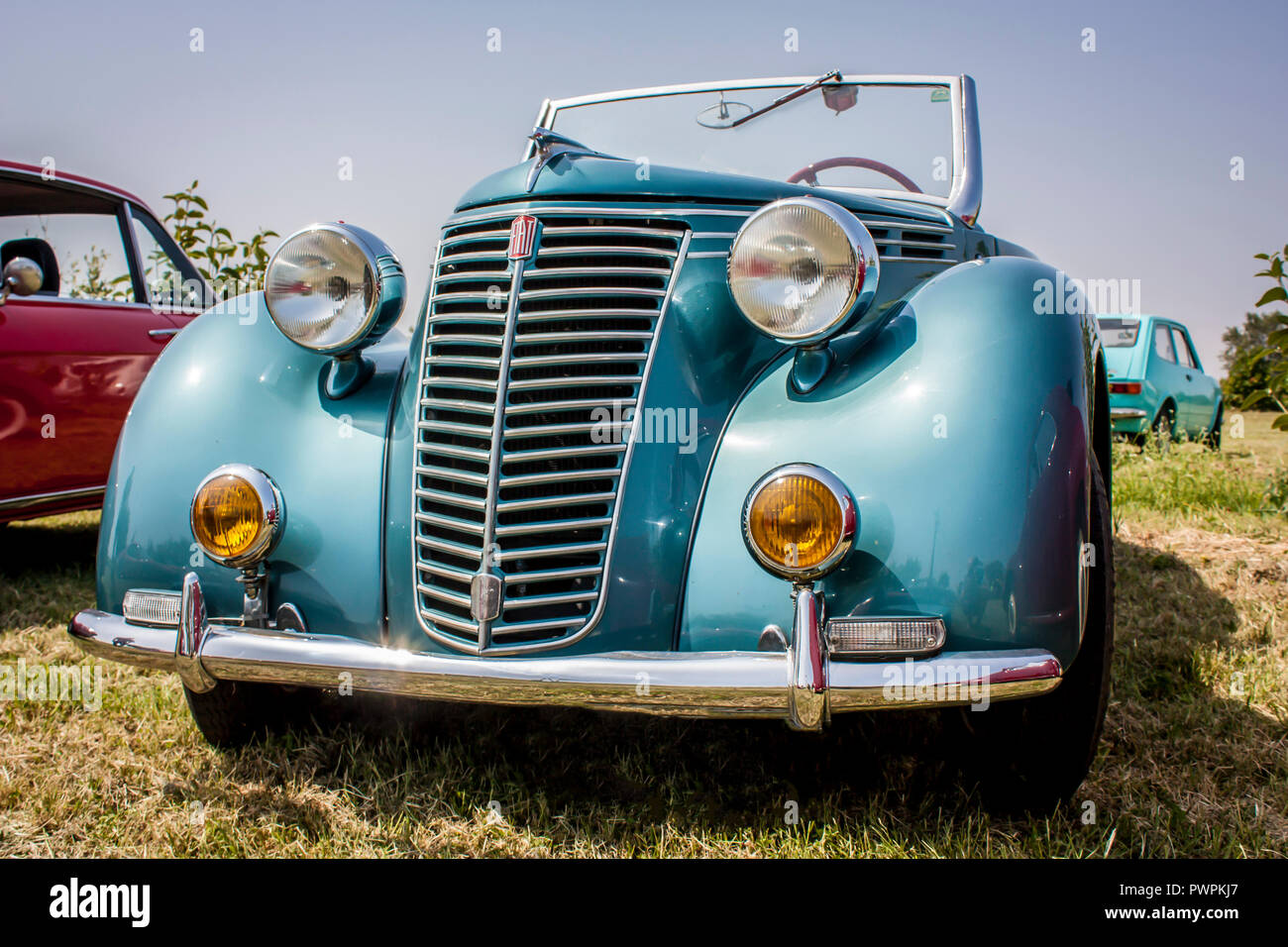 Fantastic Fiat, the Italian car era, exposed during a rally in the sunlight. Front view. - Stock Image