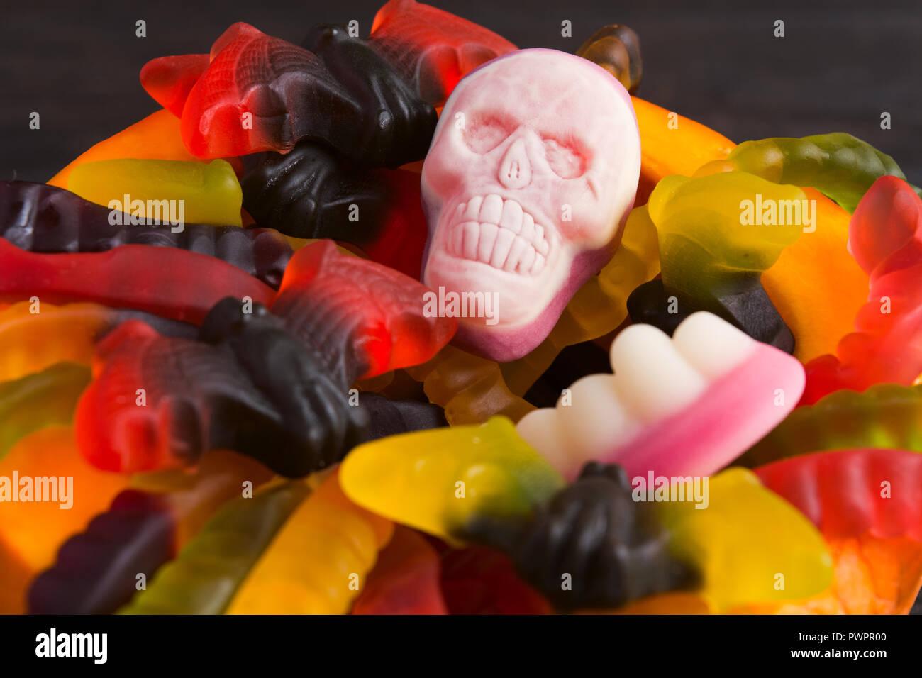 Closeup view of various Halloween candies, selective focus - Stock Image