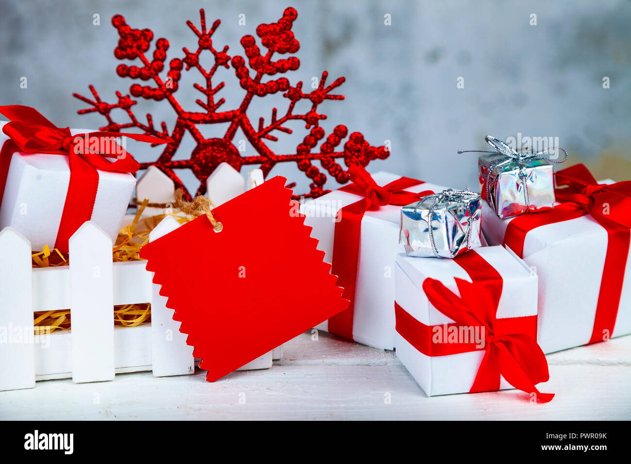 Christmas gifts and decorations in a white box on a grunge ...