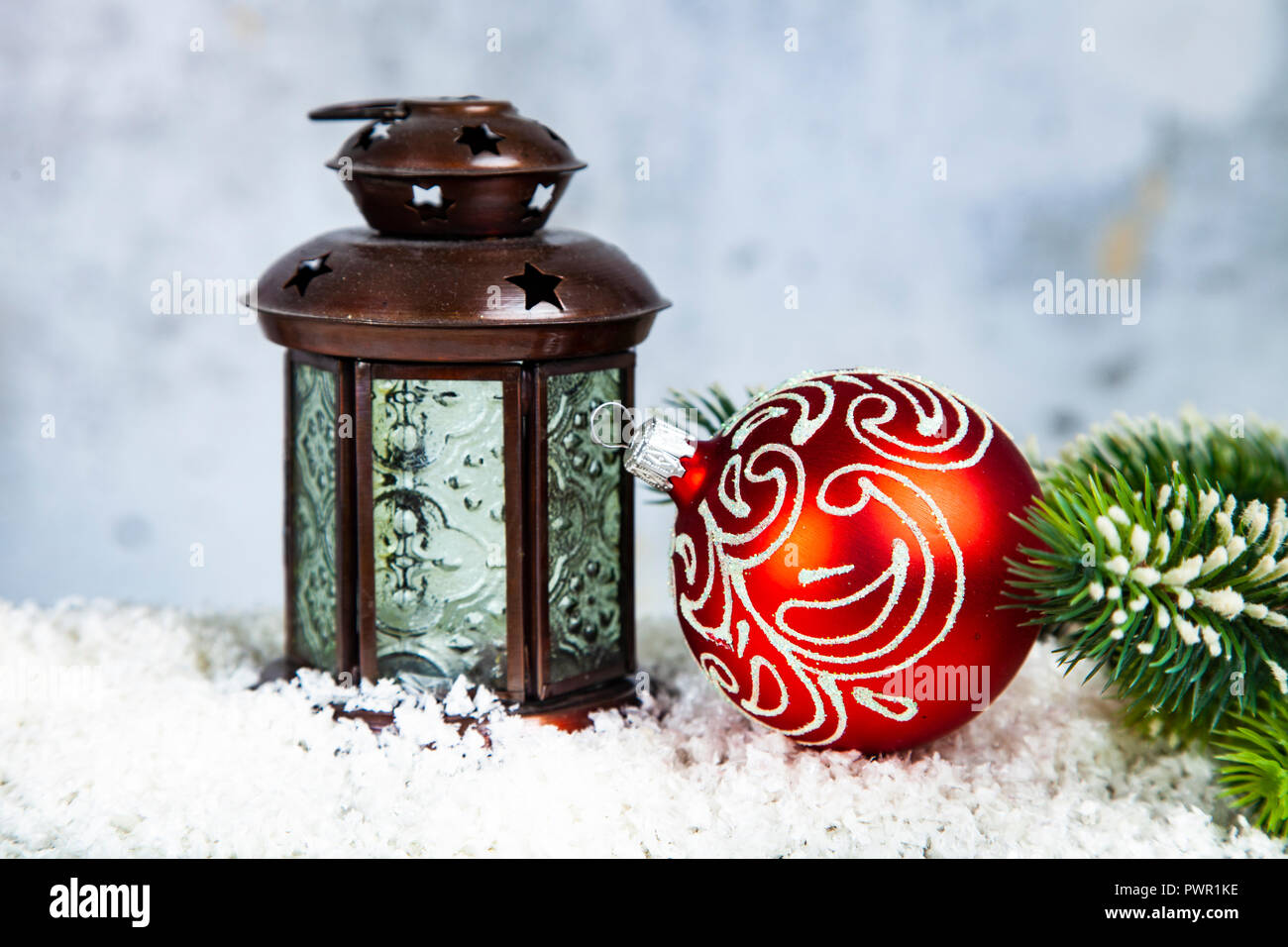 Christmas lantern, fir branch and ball on grunge background ...