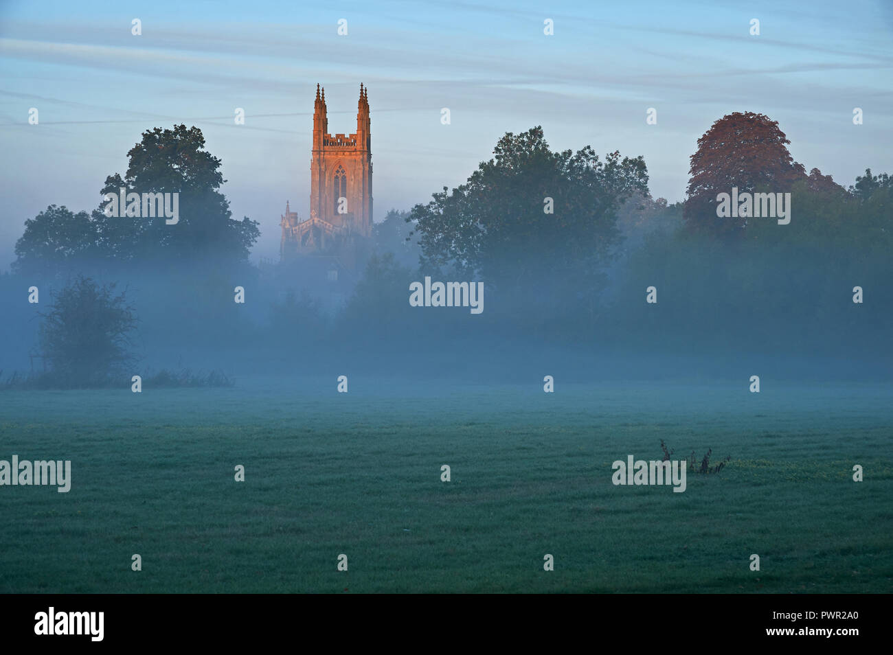 Rural village church tower on a misty autumnal morning at Hampton Lucy, Warwickshire Stock Photo