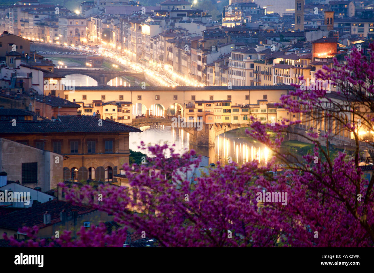 View of Ponte Vecchio Old Bridge in Florence from Piazzale Michelangelo at evening during blue hour - Stock Image
