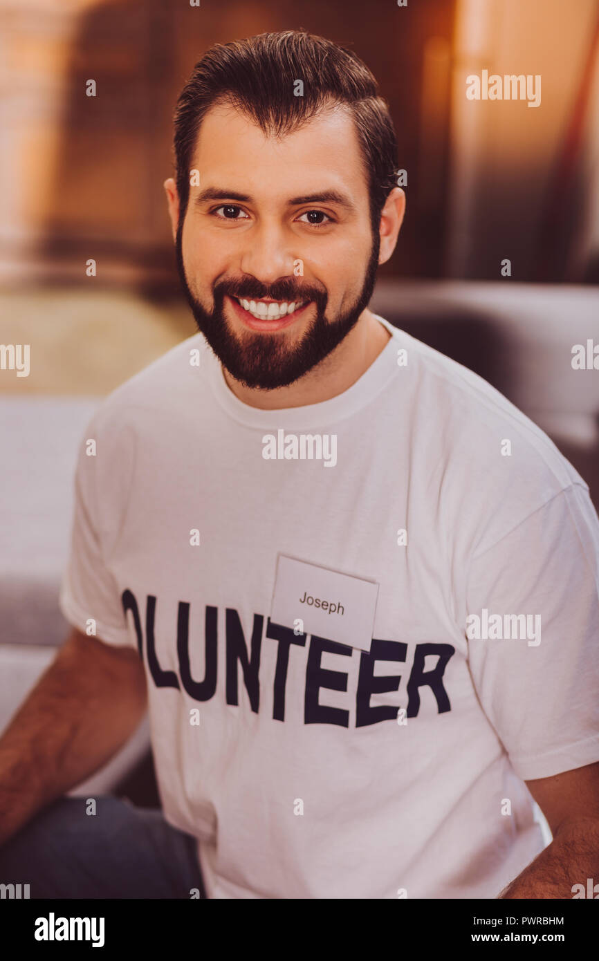 Handsome inspired young man smiling - Stock Image
