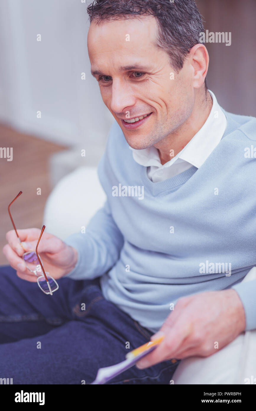Excited psychologist averting his glance - Stock Image