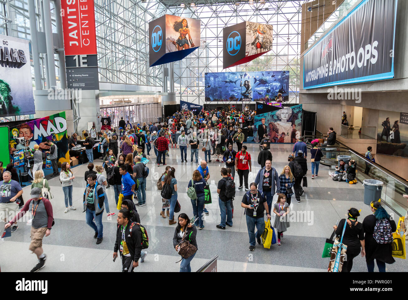 A crowd of visitors and fans to the New York Comic Con comic book and movie convention. - Stock Image