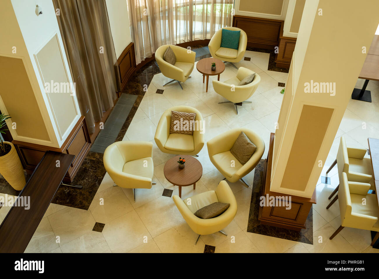 Soft Leather Chairs And Tables In The Lobby For Guests