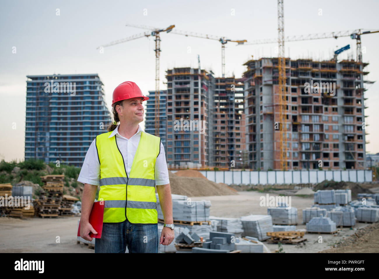 Engineer on a construction site working on housing project - Stock Image