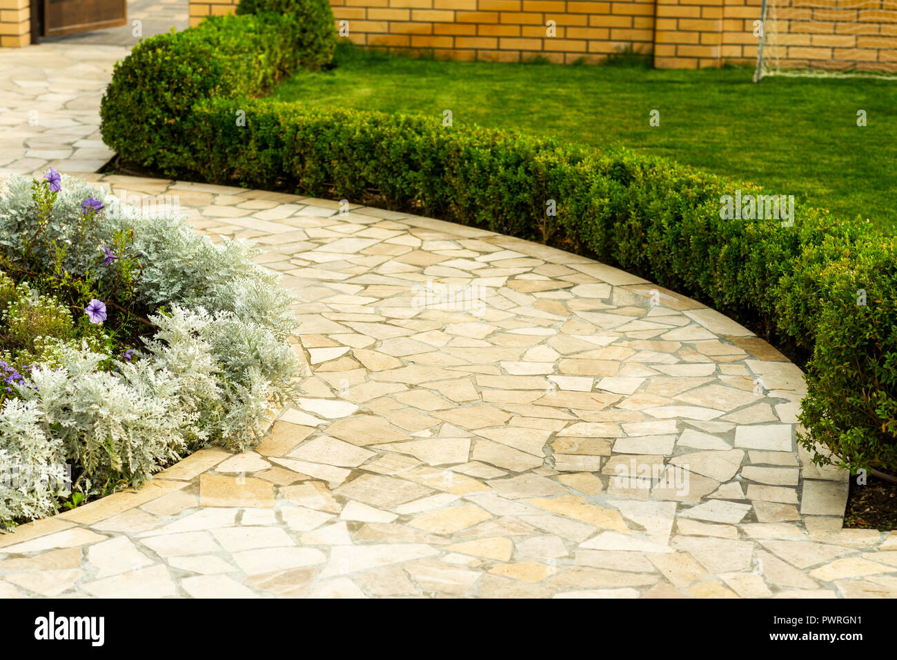 stone walkway in landscape design near the steps to the house Stock on landscape along building, landscape along drive, landscape along hillside, landscape along house, landscape along mailbox, landscape along road, landscape along roadway, landscape along bus, landscape along fencing, landscape along windows, landscape along stone wall,