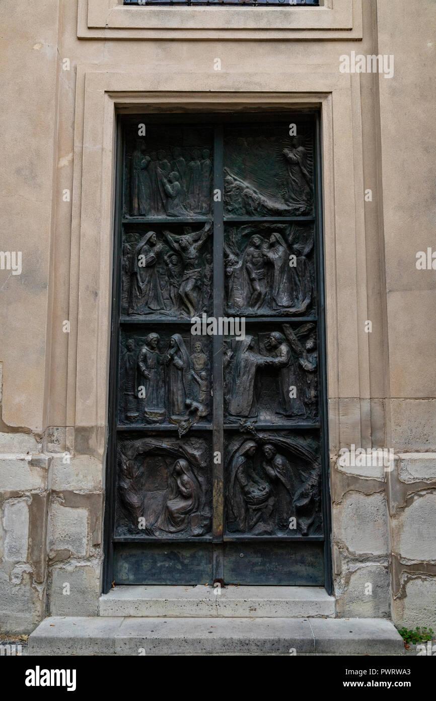 Ornate Paris Door at Church of Saint Peter of Montmartre or Paroisse Saint Pierre de Montmartre - Thousands of doors and gates adorn buildings in Pari - Stock Image
