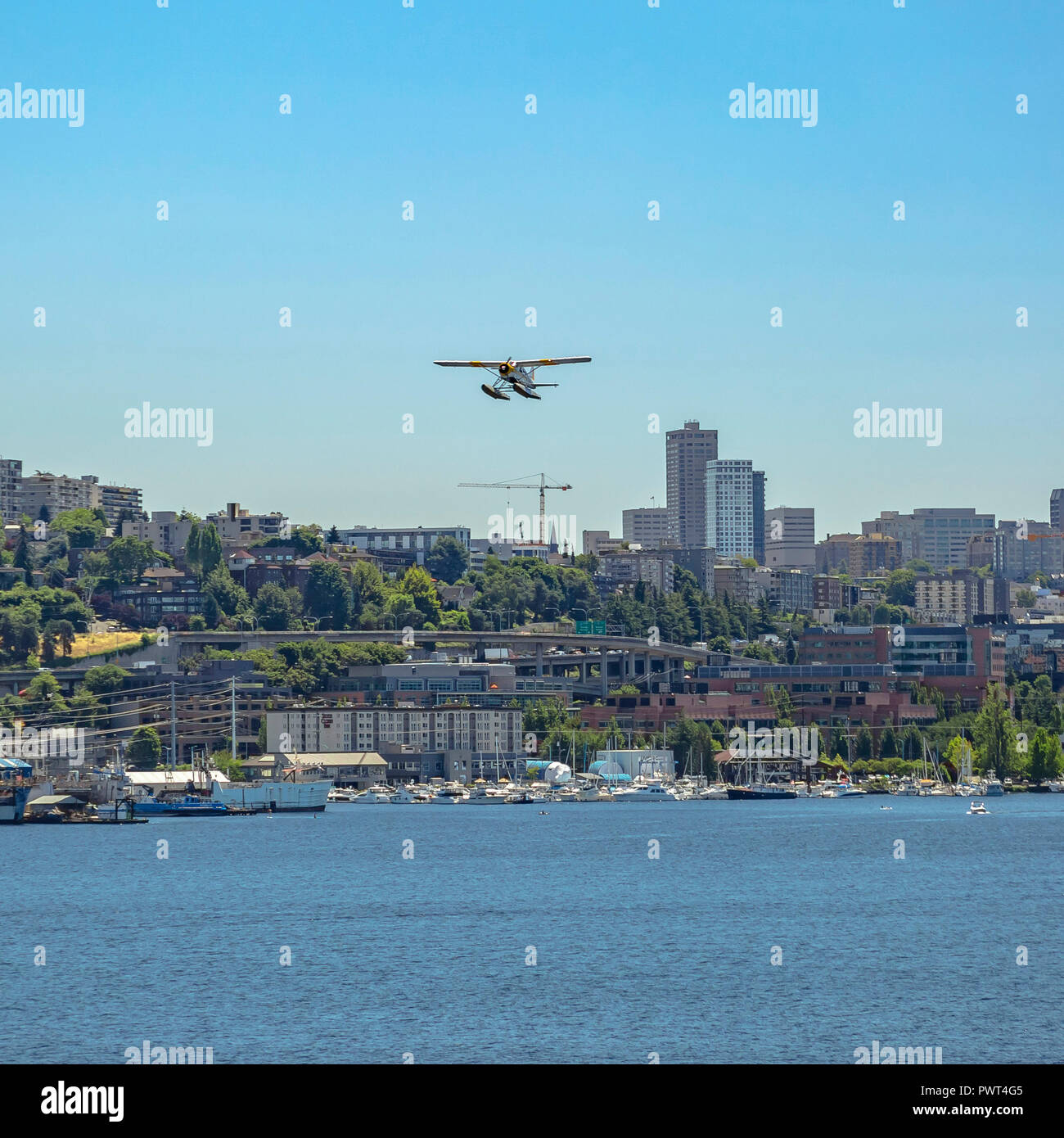 Float plane over seaport city and Union Lake - Stock Image
