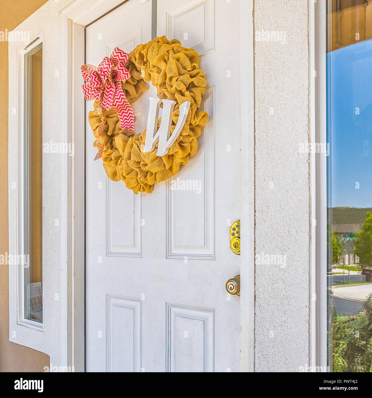Front Door With Wreath And Reflective Glass Window Stock Photo